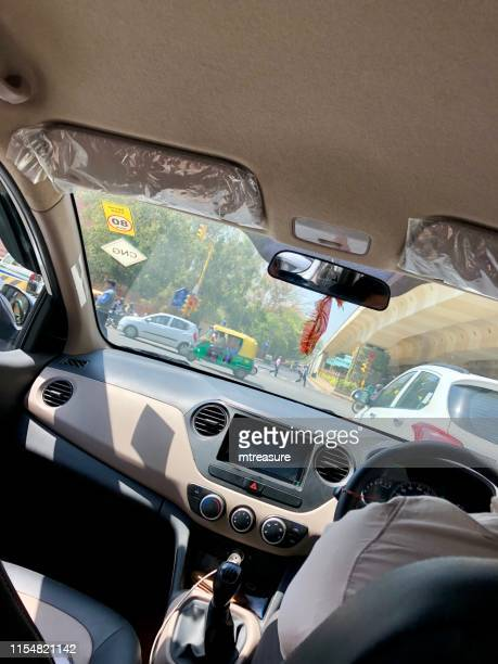 image of street view of nehru place, delhi, india, seen through taxi windcreen, cab interior - delhi stock pictures, royalty-free photos & images