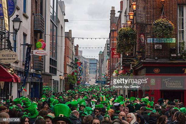 Image of the crowds gathered in Temple Bar after St Patrick's day parade in Dublin Ireland
