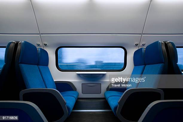 Image of uninhabited area of moving train in early morning