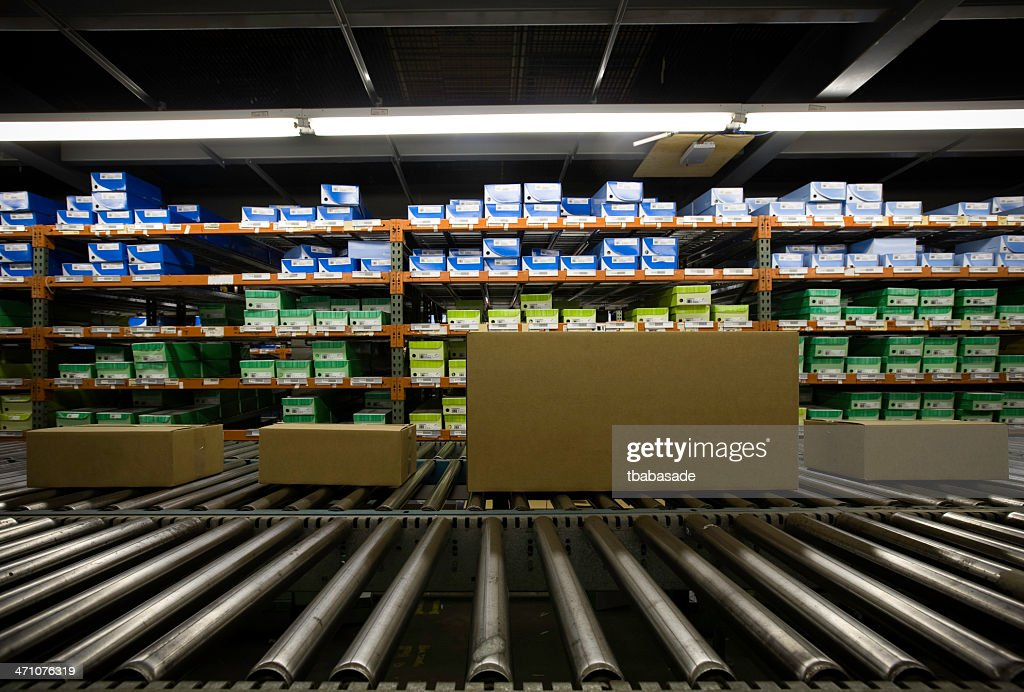 Image of warehouse full of boxes in green and blue : Stock Photo