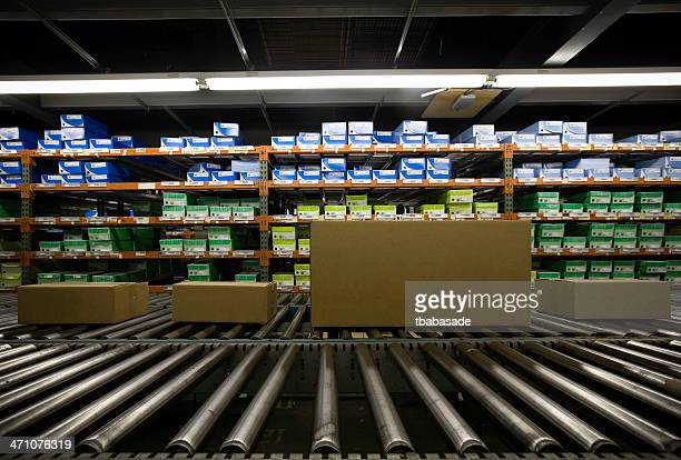 Image of warehouse full of boxes in green and blue