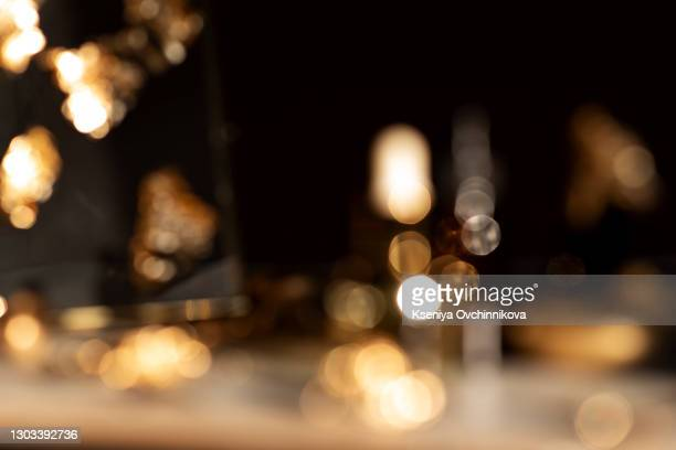 image of wooden table in front of abstract blurred background of resturant lights - alcohol stock pictures, royalty-free photos & images