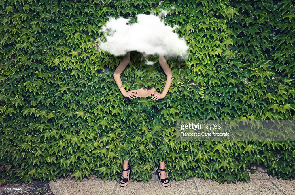 Image of young woman on ivy plants and cloud : Stock Photo