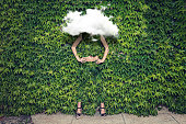 Image of young woman on ivy plants and cloud