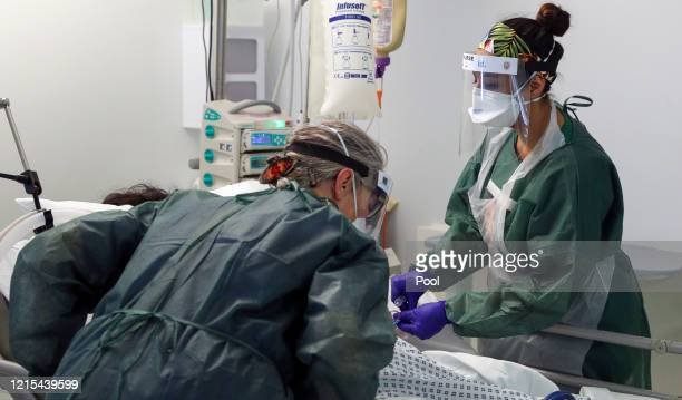 Image released on May 27, Nurses care for a patient in an Intensive Care ward treating victims of the coronavirus in Frimley Park Hospital in Surrey...