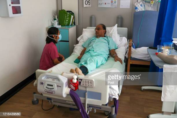 Image released on May 27 Patient Hitesh Patel talks to doctor Jasmine Gan on a Covid recovery ward at Wexham Park Hospital near Slough on May 22 2020...