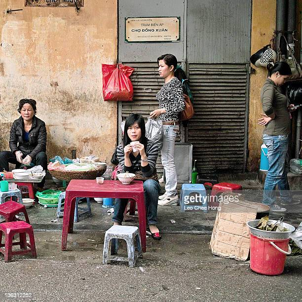 Image showing street life outside Dong Xuan Market in Hanoi, Vietnam, 2011.
