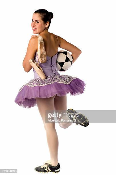 image shows a ballerina and the contrast between the arts and sports: ballet and soccer - 若い女性一人 ストックフォトと画像