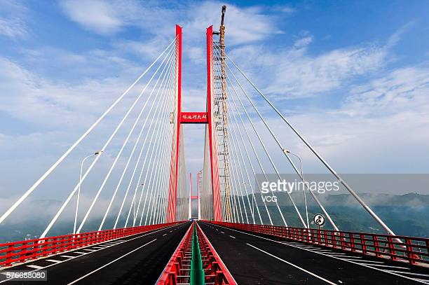 Image shows a bridge connecting express highway between Guiyang City and Qianxi County on July 16, 2016 in Guiyang, Guizhou Province of China....