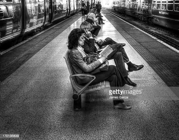 Image shows commuters waiting on platform 10 of Kings Cross station. The image is a black and white HDR image. This was taken at around 5pm on a...