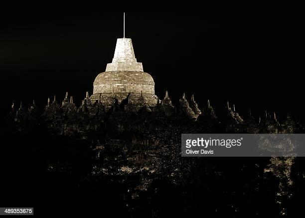 CONTENT] Image shows spotlit large central stupa and surrounding smaller stupas of Borobudur monument at night Borobudur is a 9thcentury Buddhist...