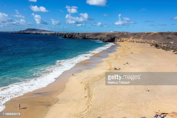 Image shows the beach of Papagayo during at Lanzarote on January 22, 2020 in Arrecife, Spain.