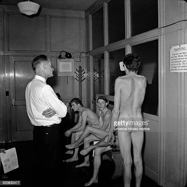 Image shows the Enlisting in the Marines the recruits undergoing a medical and physical examination San Francisco California taken in 1941