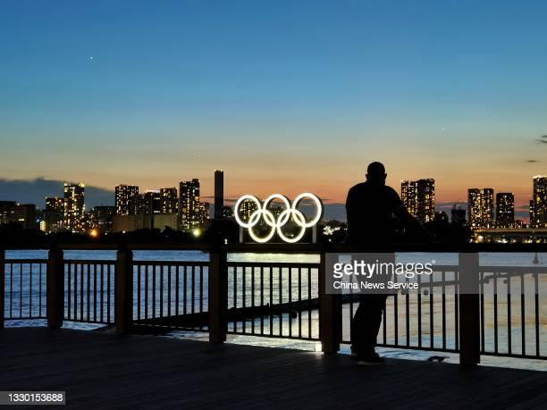 Image shows the sunset scenery of Odaiba Seaside Park, Tokyo Bay one day before the Tokyo 2020 Olympic Games, on July 22, 2021 in Tokyo, Japan.