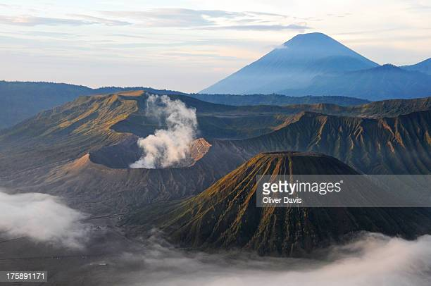 CONTENT] Image shows the volcanic complex of 'Bromo Tengger Semeru National Park' East Java Indonesia In shot can be seen swirling smoke cloud...