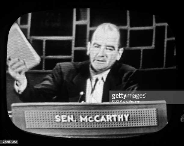 Image taken from a television screen shows Wisconsin senator Joseph McCarthy as he waves a document on the premiere broadcast of the CBS television...