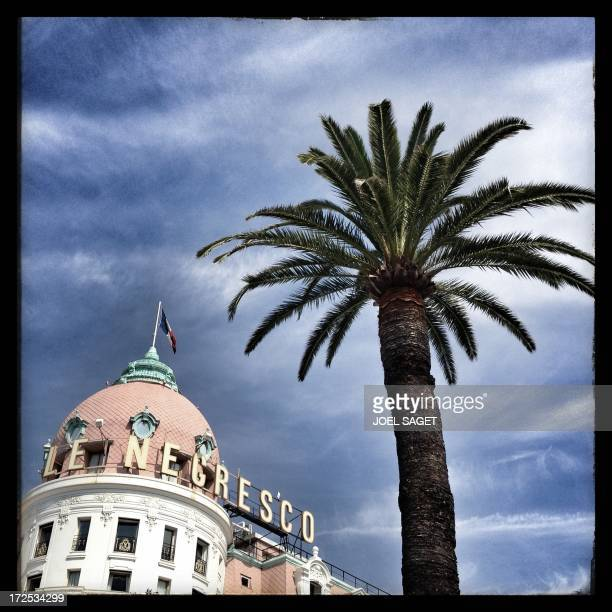 Image taken with a mobile phone shows the Hotel Negresco on the Promenade des Anglais in the French southeastern city of Nice before the start of the...