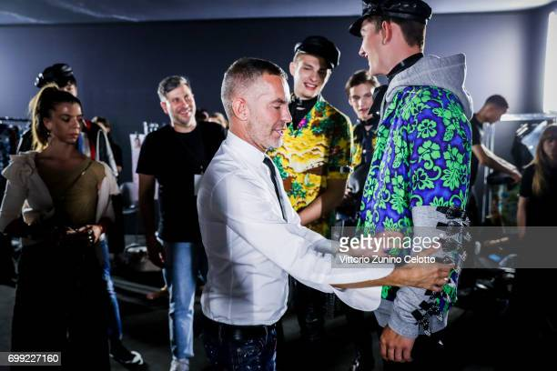 Image was altered with digital filters Dan Caten and models are seen backstage ahead of the Dsquared2 show during Milan Men's Fashion Week...