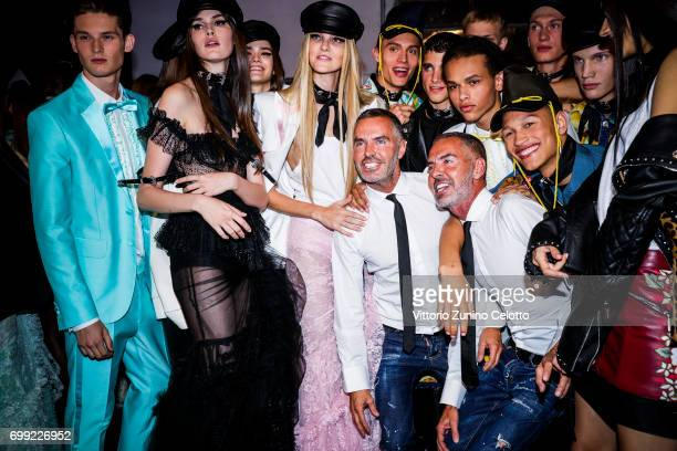 Image was altered with digital filters Dean Caten Dan Caten and models are seen backstage ahead of the Dsquared2 show during Milan Men's Fashion Week...