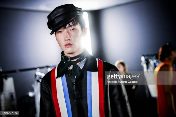 Image was altered with digital filters Model is seen backstage ahead of the Dsquared2 show during Milan Men's Fashion Week Spring/Summer 2018on June...