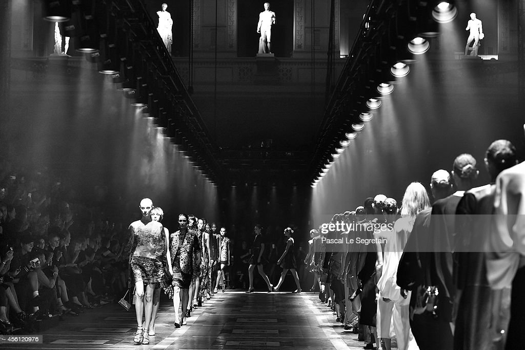 Image was created using digital filters. Models walk down the runway during the Lanvin fashion show as part of the Paris Fashion week womenswearSpring Summer 2015 on September 25, 2014 in Paris, France.
