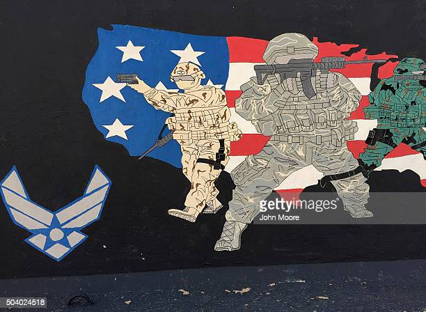 Image was taken with a smartphone A Protective blast wall stands painted by a US military unit on January 8 2016 at an air base in the Persian Gulf...