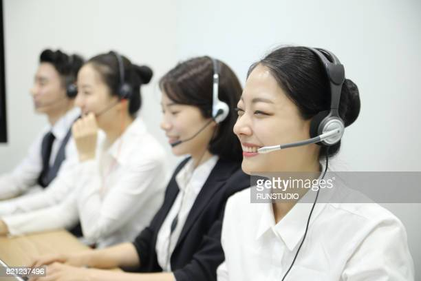 image where female employees at the call center are consulting with a smile