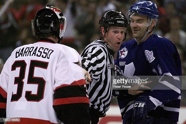Ottawa Senator netmindeR Tom Barrasso and Toronto Maple Leafs Jonas Hoglund are kept apart by linesman during first period action of game three at...
