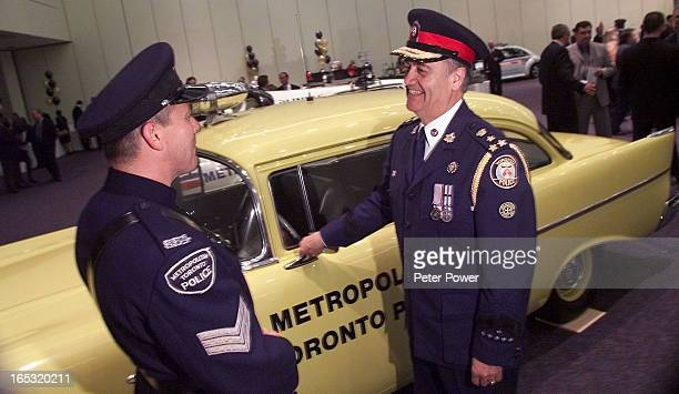 Police Chief Julian Fantino right chats with PC Robert Bowen of Crimestoppers beside a vintage Toronto Police Car before dinner It was a coincidence...