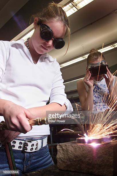 Barton High School Day 2Grade eleven students Carrie Allen left and Candice Hrushka right work on a welding project during a grade ten manufacturing...