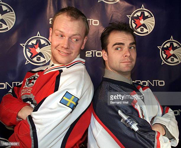 Dressed in their All Star jerseys Toronto Maple Leafs' Captain Mats Sundin and goalie Curtis Joseph give each other threatening glances during a...