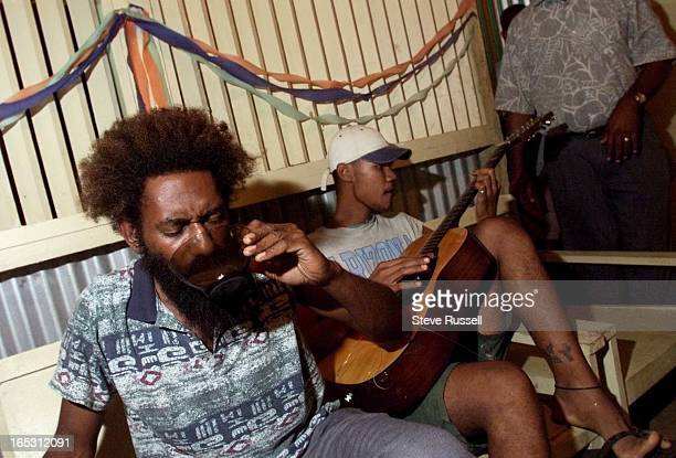 IMAGEKava relaxes you says Henry Boe Boe enjoys to have a couple bowls of kava and then strum away on his guitar which is being used by Junior Watson...