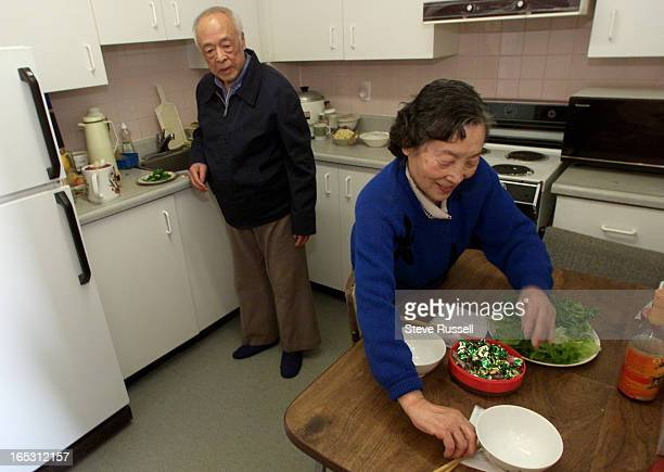 Pei-Feng Qian and Yuan-Xun Li prepare lunch before leaving for the Metro Convention Centre in Toronto, Febuary 5, 2000.