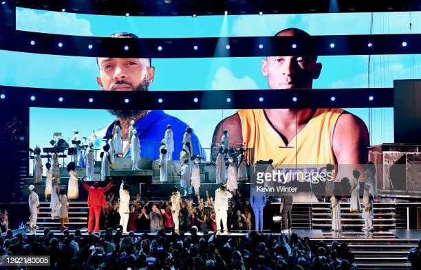 Images for the late Nipsey Hussle and Kobe Bryant are projected onto a screen while YG, John Legend, Kirk Franklin, DJ Khaled, Meek Mill, and Roddy...