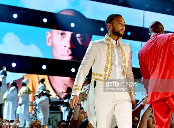 Images for the late Nipsey Hussle and Kobe Bryant are projected onto a screen while John Legend performs onstage during the 62nd Annual GRAMMY Awards...