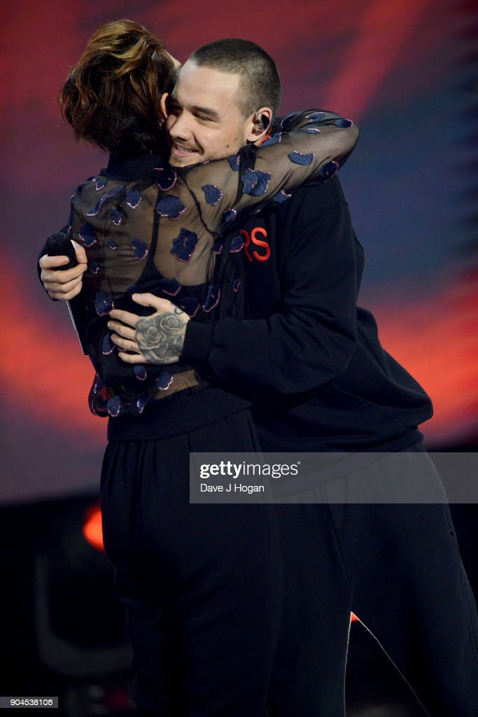 Images from this event are only to be used in relation to this event. Host Emma Willis (L) and Liam Payne on stage at The BRIT Awards 2018 nominations held at ITV Studios on January 13, 2018 in London, England.