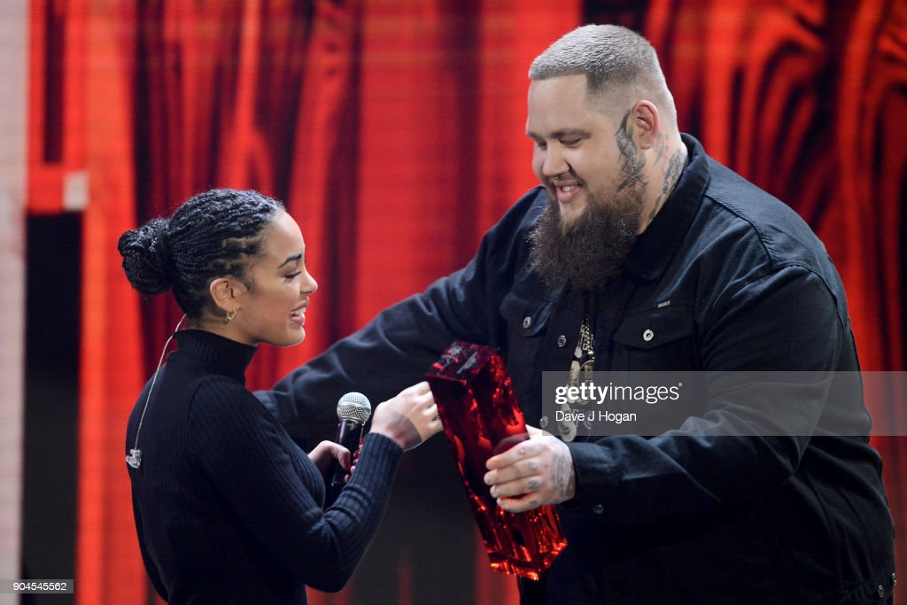 Images from this event are only to be used in relation to this event. Rag ÕnÕ Bone Man (R) presents Jorja Smith with the CriticsÕ Choice Award at The BRIT Awards 2018 nominations held at ITV Studios on January 13, 2018 in London, England.