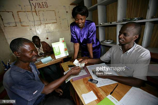 Images from various MPESA cell phone finance company offices September 13 2007 in Bungoma Kenya This company offers clients the facility of finacial...