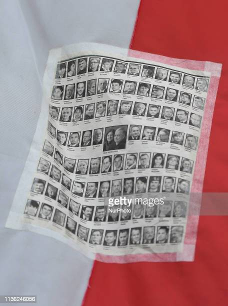 Images of 96 victims of 2010 Smolensk crash seen attached to a Polish flag outside of Katyn Cross monument near Wawel Castle on the day of the 9th...