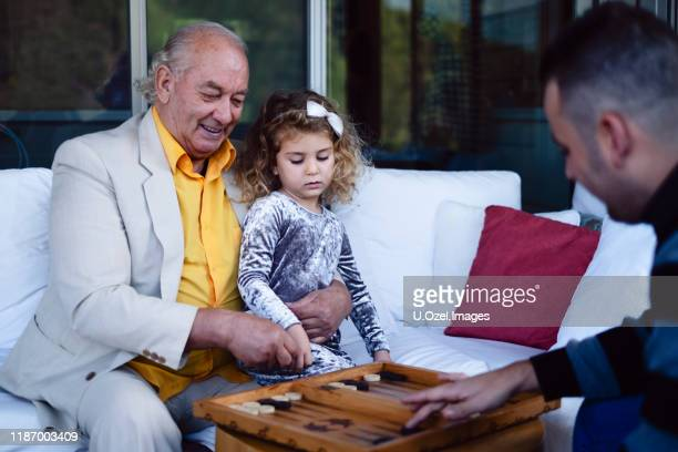 images of a domestic life of a cute family - backgammon stock pictures, royalty-free photos & images