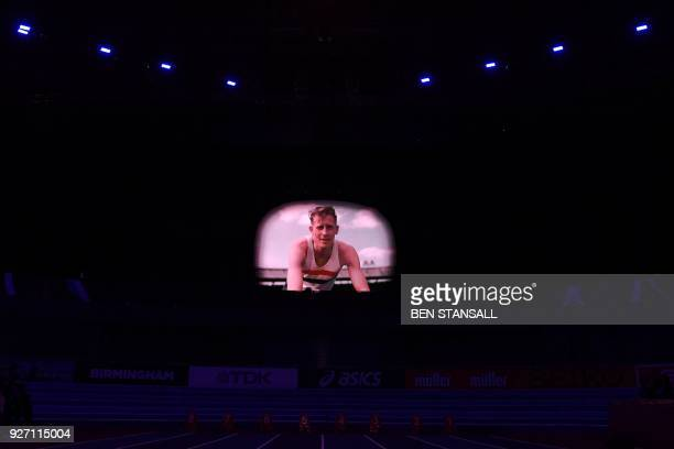 Images of British legendary runner Roger Bannister are projected within the arena during the 2018 IAAF World Indoor Athletics Championships at the...