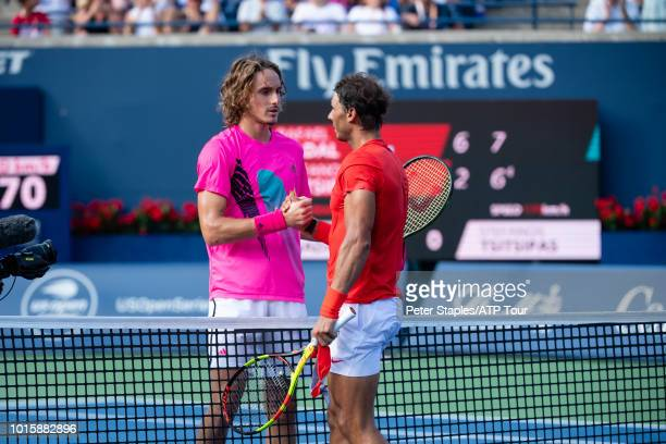Images of championship winner Rafael Nadal of Spain shakes hands at the net with finalist Stefanos Tsitsipas of Greece on Day Seven at the Rogers Cup...