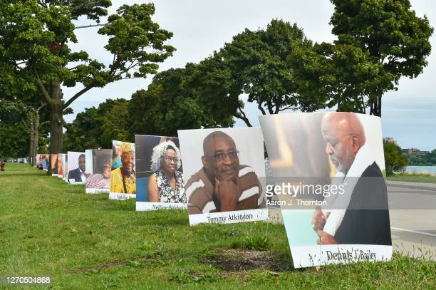 Images of COVID-19 victims from Detroit are displayed in a drive-by memorial at Belle Isle State Park on September 2, 2020 in Detroit, Michigan....