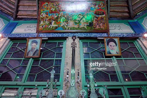 Images of Iran's two supreme religious leaders Ayatollah Sayed Ali Khamenei and Ayatollah Ruhollah Khomeini hang on the wall of a religious...