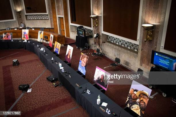 Images of people who have been helped by the Affordable Care Act occupy the seats of Democratic senators boycotting a Senate Judiciary Committee...