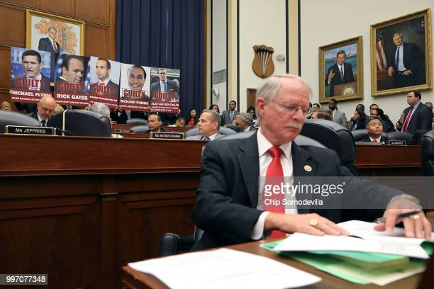 Images of people who have plead guilty in Special Counsel Robert Mueller's investigation are displayed as House Oversight and Government Reform...