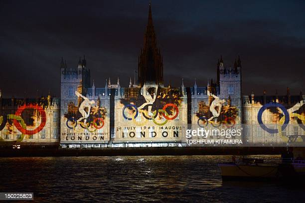 Images of the logo of the London 1948 Olympic games are displayed on the wall of the Houses of Parliament as part of the festivities for the closing...