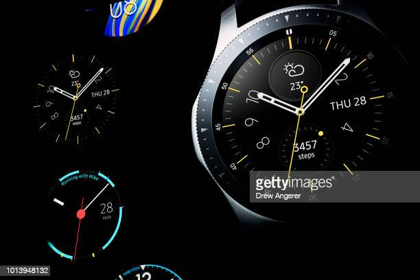 Images of the new Samsung Galaxy Watch are displayed on a projection screen during a product launch event at the Barclays Center on August 9 2018 in...