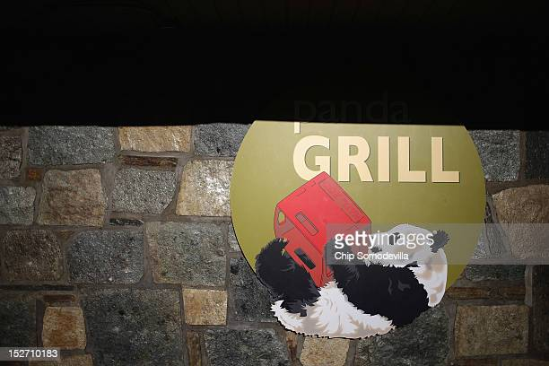 Images of the Smithsonian National Zoological Park's giant pandas is displayed at a grill the day after the death of a sixdayold panda cub at the zoo...