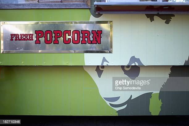 Images of the Smithsonian National Zoological Park's giant pandas is displayed on a popcorn cart the day after the death of a sixdayold panda cub at...